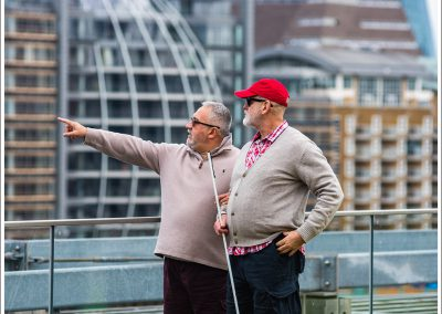 A blind man surveying London's architecture